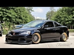 Sick Black RSX with Gold rims lowered, slammed and perfected.  Man I like this!
