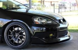 Another great shot of a black Acrua RSX with black rims and sick lip!